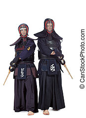 helmets - Two kendo fighters posing together over white...