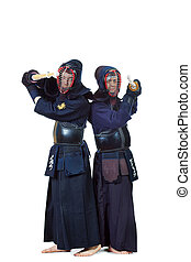 black clothes - Two kendo fighters posing together over...
