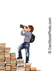 climbing - A boy climbing the stairs of books and looking...