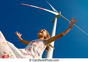 playing with the wind - child playing with the wind near a...