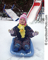 Cute child on winter sledge - Cute smiling child wearing...