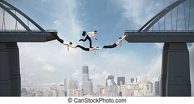 Teamwork concept with running businessman over the bridge