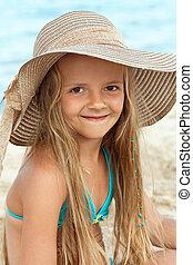 Little girl on the beach portrait