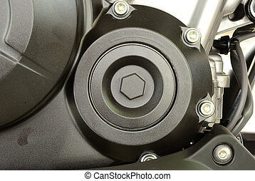 Close up on a water pump cover of motorcycle engine