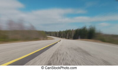 Fast blurred driving over highway