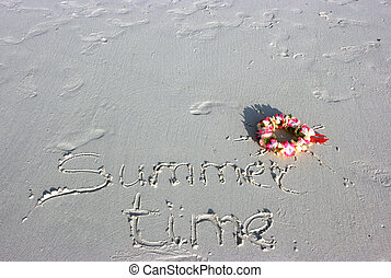 Summer time inscription and sun wreath on the sand