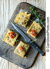 Polenta slices with cherry tomatoes, top view, food