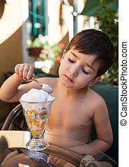 little boy eating ice cream - Portrait of 4-5 years old boy...