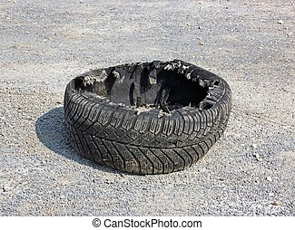 Fragmented tire left on the road