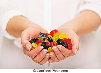 Plenty of Candies You Can Choose From - Woman with a handful...