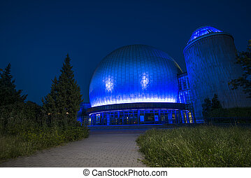 planetarium in Berlin illuminated with blue light at night