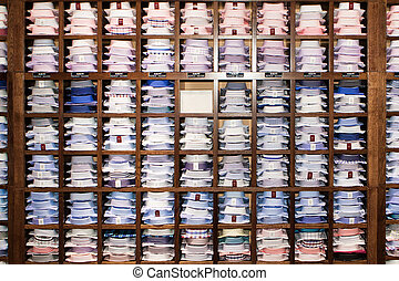Shirts on a Shelf - Shirts lay ready for selling in a...