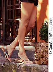 summer slippers - woman legs in summer flat slippers outdoor...