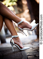 legs in high heels - woman legs in elegant white high heel...