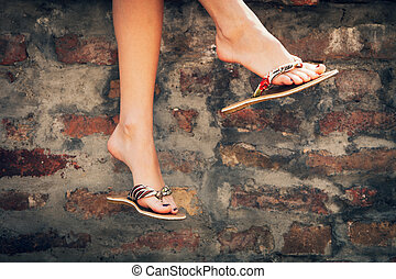 summer slippers - woman legs in summer slippers outdoor day...