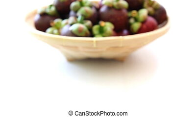 close-up mangosteen on a basket - close-up mangosteen which...
