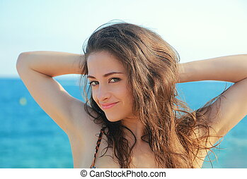 Happy smiling woman looking on blue sea background. Closeup...
