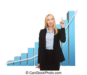 businesswoman pointing at big 3d chart - business concept -...