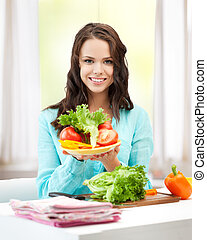 woman in the kitchen with vegetables - healthy food concept...