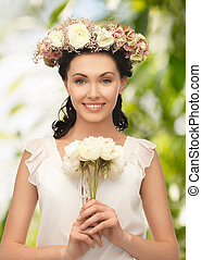 young woman with flower - wedding and beauty concept - young...