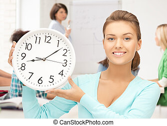 attractive student pointing at clock - education and time...