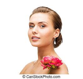 woman wearing earrings with flower