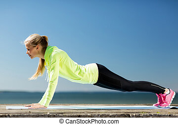 woman doing sports outdoors - sport and lifestyle concept -...