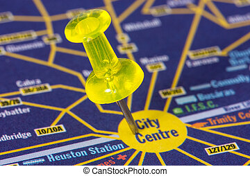 Pushpin on the map showing city center - Yellow pushpin on...