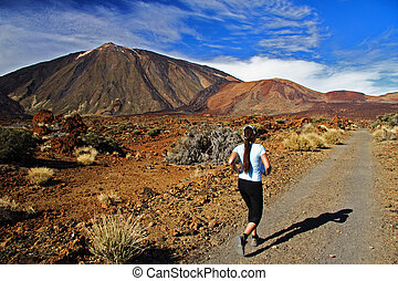 Running woman - Woman running. Trail running on the Volcano...
