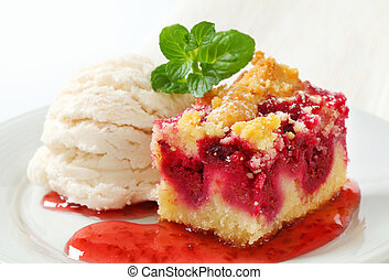 Berry fruit crumble slice with ice cream and raspberry sauce