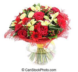 Flower arrangement in glass, transparent vase: red roses,...