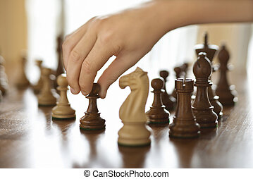 Hand moving chess piece. - Caucasian person hand moving...