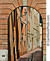 Street with arch in France - Street with arch made of red...