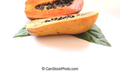 Close-up cutting half papaya