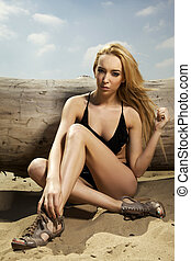 beautiful blonde woman in black swimwear