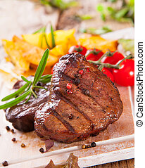 Grilled steak - Grilled beef steak served on wood