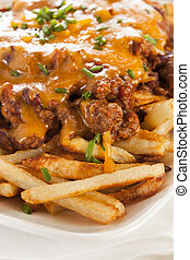 Unhealthy Messy Chili Cheese Fries on a Background