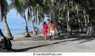 Romantic couple at tropical beach in Philippines