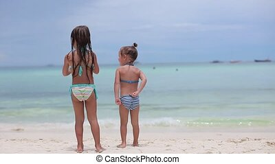 two little sisters at tropical beach