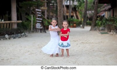 Little adorable girls in exotic resort in nice dress