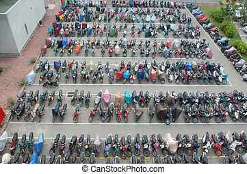 Bird view of a parking lot filled but motorcycles in Saigon...