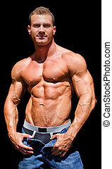 Handsome young bodybuilder shirless, isolated on black -...