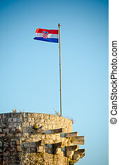 The Croatian Flag flying high on a vintage wall in Hvar...