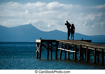 Family Silhouette Sea Landscape - Silhouette of a family at...