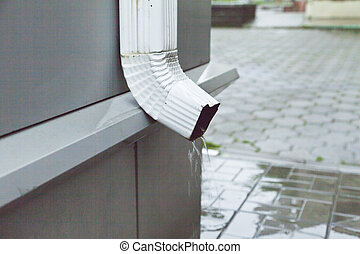 Drainpipe - The drainpipe is located on the house for...