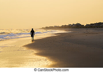 Boy walking on beach - Caucasian pre-teen boy walking...