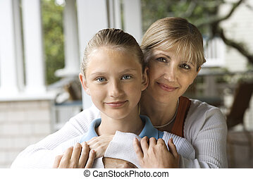 Mom and daughter hugging.