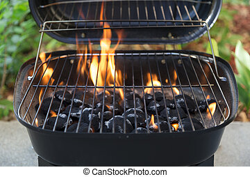 charcoal grill and flames close up