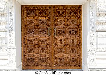 ornamented door - ornated wooden front door in a hindu...