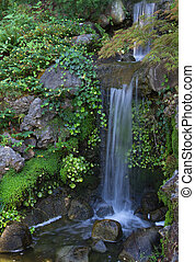 Small waterfall - Landscape with small summer waterfall,...